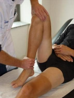 Passive hyperflexion of the knee.